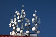 Wireless point. Several wireless, satellite and mobile phone antennas Royalty Free Stock Photos