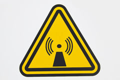 Wireless radiation sign. Seen by the cellular tower Royalty Free Stock Photo
