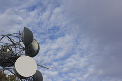 Wireless radio antennas with clouds Stock Images