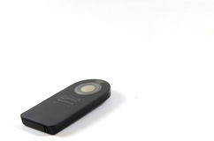 Wireless remote. Black remote  on white background Stock Photography