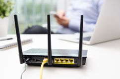 Free Wireless Router And Man Using A Smart Phone In Home Stock Photos - 102901043