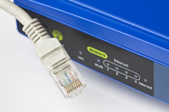 Wireless router and Lan cable Royalty Free Stock Image