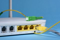 Wireless router with network patch cord and optical cable Stock Photos