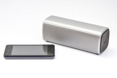Wireless speaker connected to mobile phone royalty free stock photography