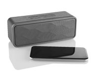 Wireless speaker and mobile phone Royalty Free Stock Photos
