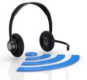 Wireless symbol and headphones Stock Photography