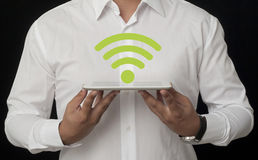 Wireless on Tablet. Wifi Symbol on the White Digital Tablet Stock Images