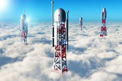 Wireless telecommunication towers in the sky above the clouds. Creative abstract wireless communication technology business industry concept: 3D render Royalty Free Stock Photos