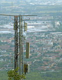 Wireless telecommunications antenna over the immense metropolis Royalty Free Stock Image