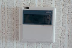 Wireless thermostat for ambient temperature control in hotel stock photo