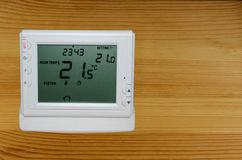 Wireless thermostat for ambient temperature control. Placed on a desk Stock Photos