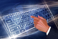 Wireless touch. Transparent keyboard to represent wireless touch Stock Photo