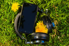 Wireless travel headphones and smartphone Royalty Free Stock Images