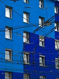 Wires. Tram wires over the contrast blue house wall Royalty Free Stock Image
