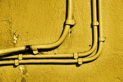 Wires. On yellow concrete wall Royalty Free Stock Photos