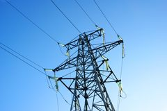 Wires. High-voltage line electrified  on background blue sky Stock Photo