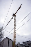 Wires and a crane. On a construction site in the city center Stock Image