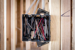 Wires exposed in an electrical box Royalty Free Stock Photo