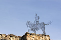 Wires horseman. Horseman made  from wires on stone wall Royalty Free Stock Photography