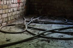 Wires and hoses on the floor Royalty Free Stock Photos