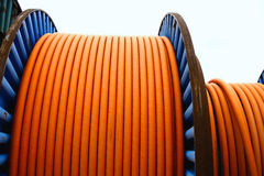 Wires on metal spool. Orange wires on metal spool Stock Photos
