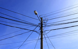 Wires over blue sky Stock Images