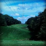 Wires over rolling hills Royalty Free Stock Photography