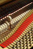The wires of a piano. Interior of concert grand piano Royalty Free Stock Images