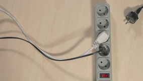 Wires pluged in power strip stock video footage