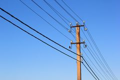 Wires and power line insulators on an electrical pole.  Royalty Free Stock Images