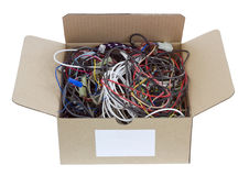 Wires is prepared for utilization. The heap of old copper wires in a cardboard box is prepared for utilization. Isolated with patch Royalty Free Stock Image