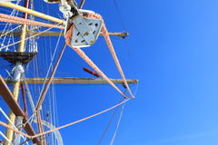 Wires, rope detail, rigging of boat. Blue sky through the wires, rope detail, rigging of boat Royalty Free Stock Photo