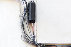 Wires on a white wall Stock Photos