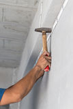 Wiring,building, construction,han,hammered,white,. Authorities are wiring new construction. using a hammer as a tool Royalty Free Stock Image