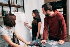 Wiring diagram drawing on whiteboard, teamwork Stock Photos