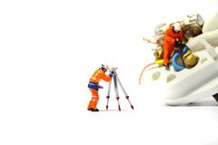 Wiring electric plug model workers B Royalty Free Stock Photos