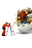 Wiring electric plug model workers E Royalty Free Stock Image