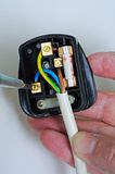Wiring an English plug. Stock Photography
