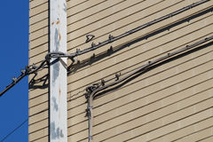 Wiring of the facade .Messy cables and electrical boxes in a wall Stock Images