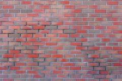 Wirkliche Backsteinmauer mit verschiedenen Farben des Steins Lizenzfreies Stockbild