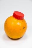 Wirkliche orange Fruchtflasche Stockbilder