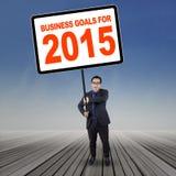 Wirtschaftler mit Unternehmenszielen für 2015 Lizenzfreie Stockfotos