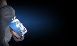 Wirtschaftler Showing Mobile Phone Lizenzfreies Stockbild