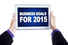 Wirtschaftlerhände mit Unternehmenszielen für 2015 Stockfotos