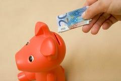 Wirtschaftlichkeitquerneigung-Finanzschwein Stockfotos