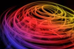 Wirujący wielo- kolor zaświeca wokoło butów na ciemnym tle Zdjęcie Stock