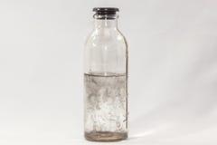 Wirus, szklana butelka, biały tło Fotografia Stock