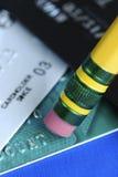 Wis de schuld op de creditcards royalty-vrije stock afbeeldingen