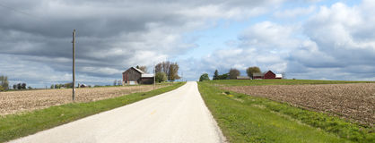 Wisconsin Dairy Farm Country Road Panoramic Banner. Old Wisconsin dairy farm and rural country road. Barns and fields can be seen in the image. Several images Stock Image