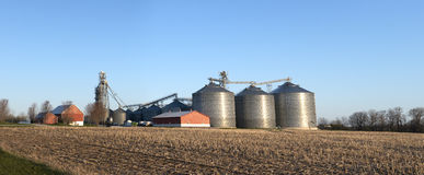 Wisconsin Dairy Farm Grain Elevator Silos. Grain elevator silos on a Wisconsin dairy farm. This is a large panorama or panoramic banner type image. The dairy Royalty Free Stock Photography